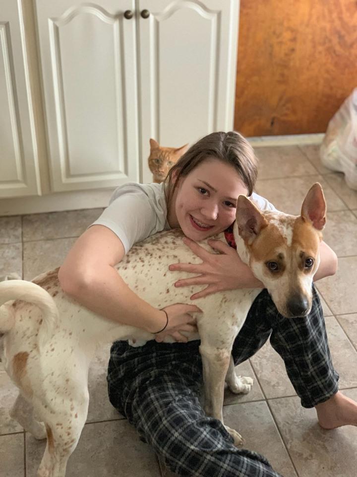 Caitlin Frangel hugging dog